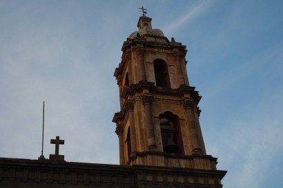 A church spire off a plaza at SLP