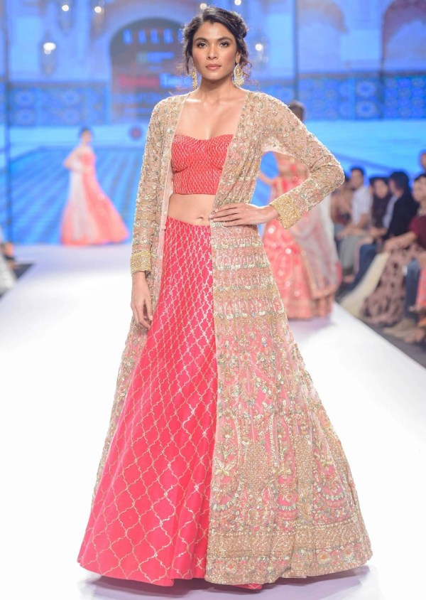 Hot Pink Lehenga And Corset Paired With Heavy Embroidered