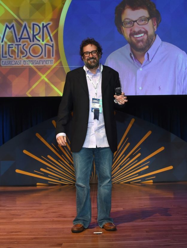 NASHVILLE, TN - OCTOBER 11: Mark Letson of Eastcoast Entertainment accepts the Corporate Buyer of the Year Award at the 2016 IEBA Honors and Awards Ceremony during day 3 of the IEBA 2016 Conference on October 11, 2016 in Nashville, Tennessee. (Photo by Rick Diamond/Getty Images for IEBA)