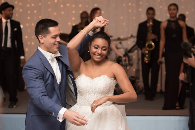 Bride and groom dancing with Sol Fusion wedding band in background