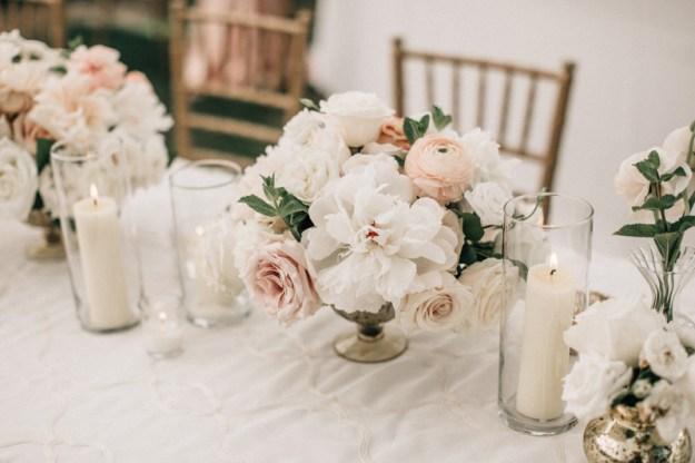 Low wedding centerpiece with blush florals