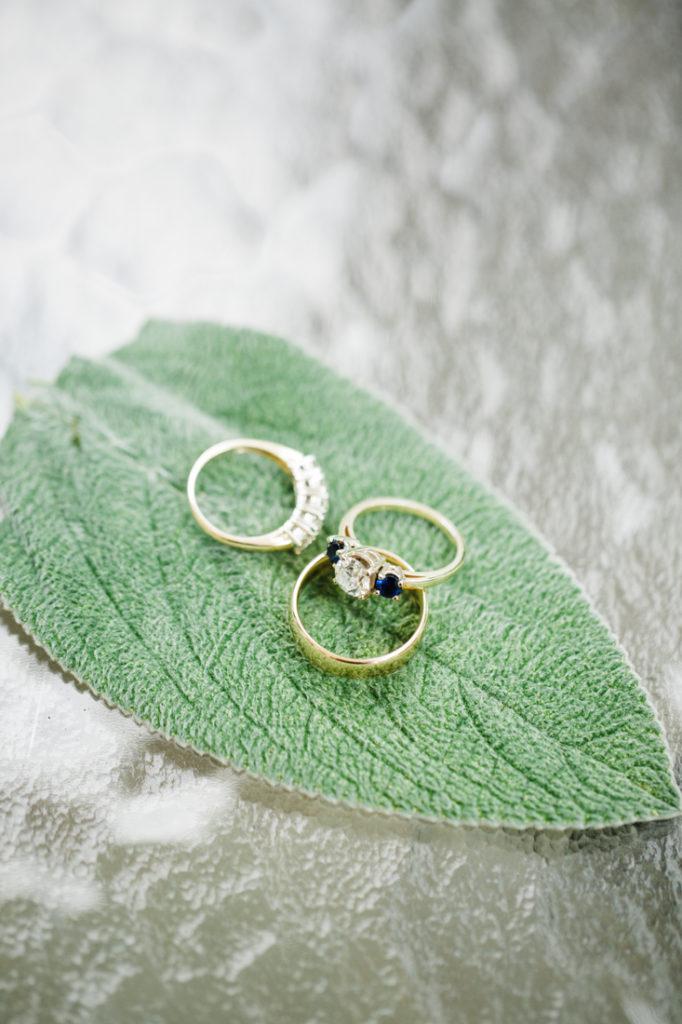 Wedding rings laying on leaf