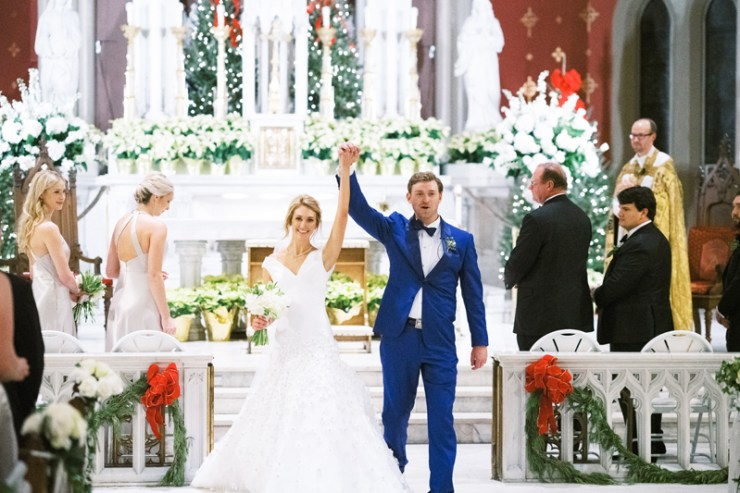 Bride and groom exiting the  Holy Name of Jesus Church in Nola after wedding