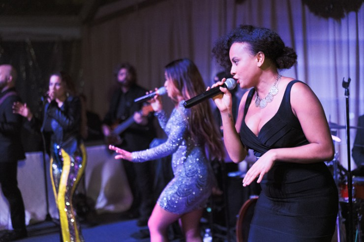 Powerhouse band singers performing at New Orleans wedding reception.