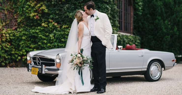 Bride and Groom in front of vintage car at Dover Hall wedding