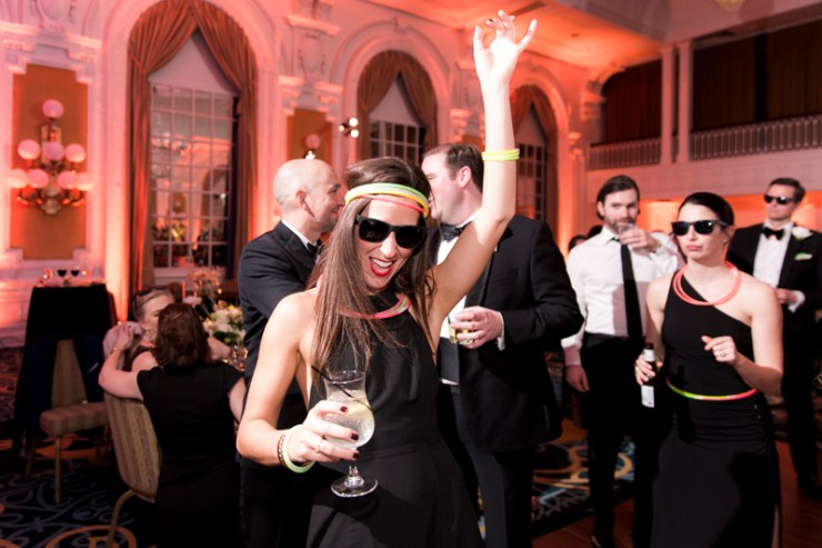 Wedding guest with glow sticks dancing at The Jefferson Hotel wedding.