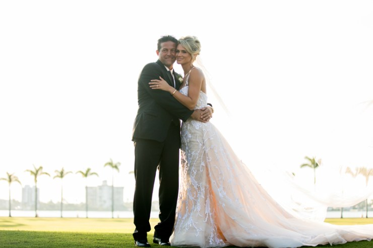 Bride and groom posing outside Mar-a-Lago during Palm Beach wedding.