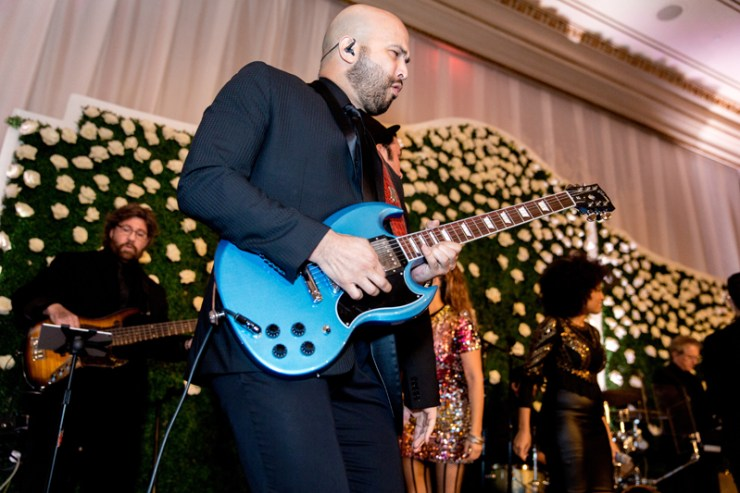 Guitarist from Powerhouse wedding band on stage during Palm Beach wedding at Mar-a-Lago.
