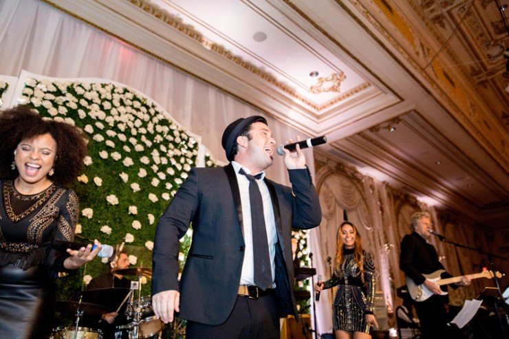 Lead male vocalist of Powerhouse band during Palm Beach wedding at Mar-a-Lago resort.