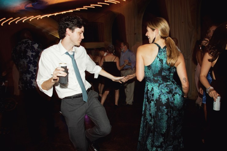 Couple on dance floor at wedding reception dancing to Loose Chain.