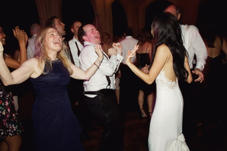 Wedding guests dancing to Loose Chain band.