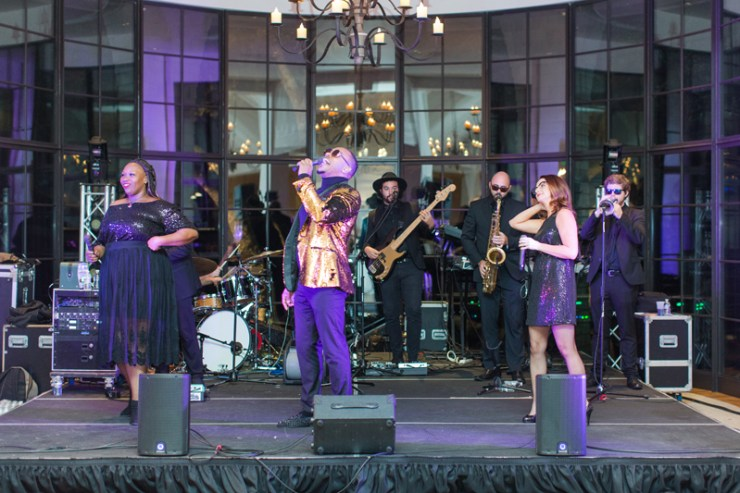 Kiawah Island Club wedding reception with The Royals band performing on stage.