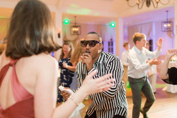 Lead male vocalist for The Royals band performing on dance floor at Kiawah Island Club wedding.
