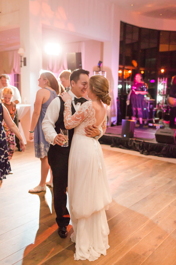 Bride and groom dancing in front of The Royals wedding band at Kiawah Island Club