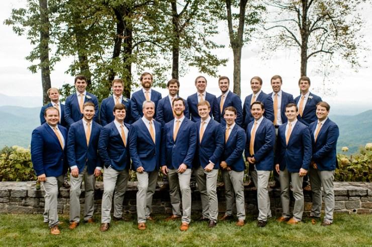 Groom and groomsmen posing at Roaring Gap Club wedding.