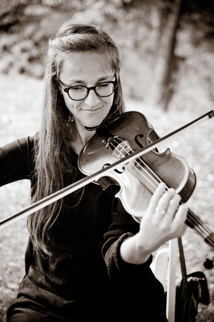 Violinist performing at wedding ceremony at Biltmore Estate.
