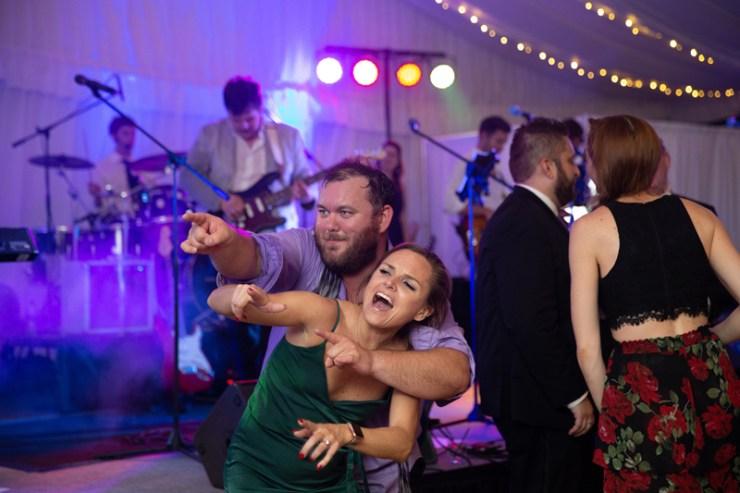 Guests dancing at wedding reception at Biltmore Estate.