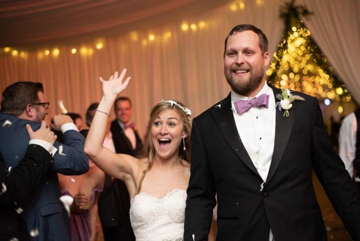Bride and groom exiting Biltmore wedding reception.
