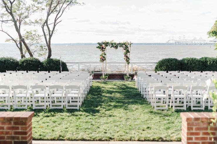 Waterfront wedding ceremony setup at Bride and groom dancing The Hora at Jewish wedding at Chesapeake Bay Beach Club wedding.