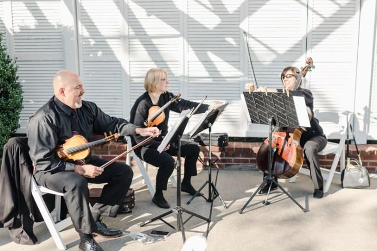 String trio musicians performing at Bride and groom dancing The Hora at Jewish wedding at Chesapeake Bay Beach Club wedding.