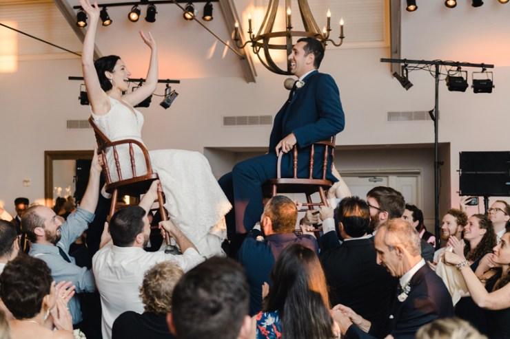 Bride and groom dancing The Hora at Jewish wedding at Chesapeake Bay Beach Club.