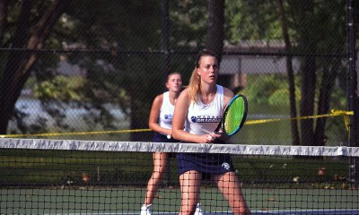 (Photo by Brian Hagberg: Warren's Amanda Gray (front) and Kamryn Moore (back) get set in their doubles match today against Erie.)