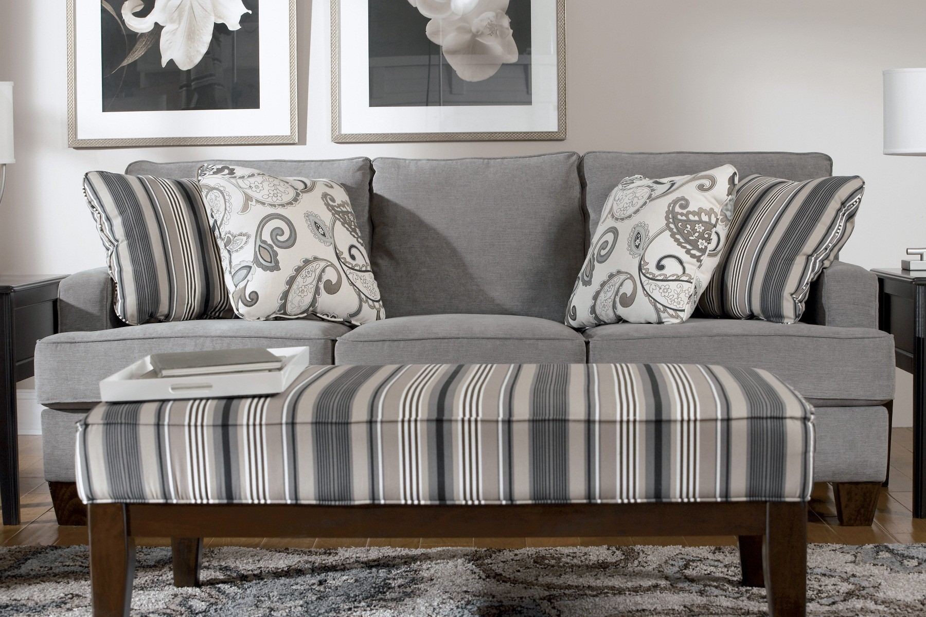 steel sofa set online chennai small es configurable sectional multiple colors walmart yvette living room from ashley 77900 coleman