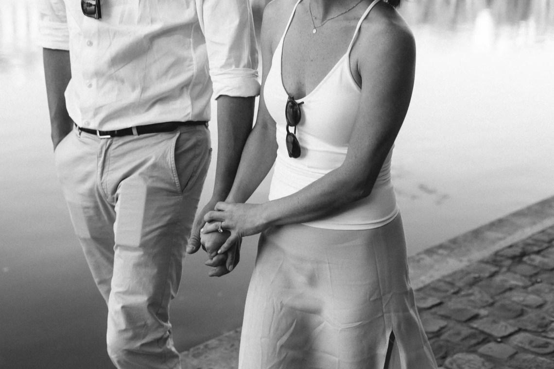 Couple Paris Seine Engagement holding hands