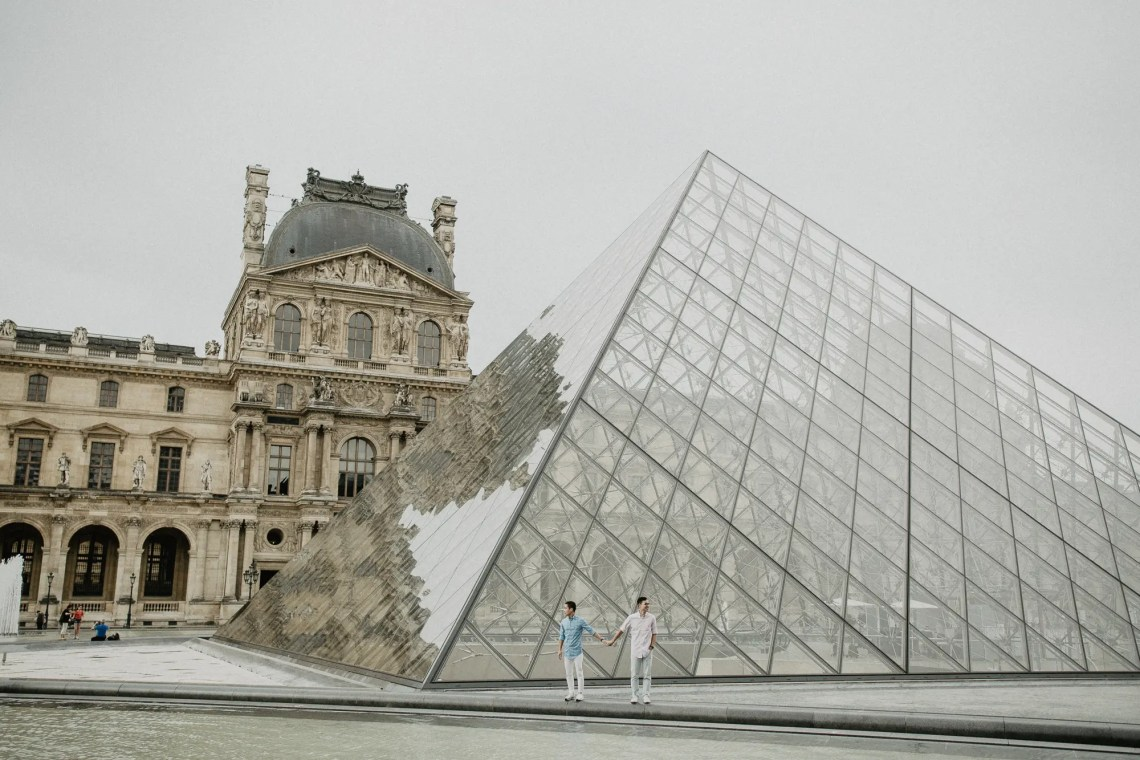 Away We Wow - gay same sex couple photography paris - Louvre Museum Pyramid travel blogger