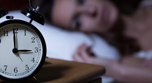 Photo of a woman looking at a clock