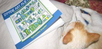 Tofu kitty or the book? Tough choice.