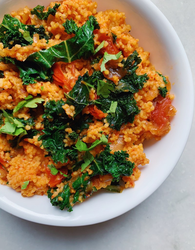 Best Roasted Red Pepper Couscous with Garlicky Tomatoes, Onions, and Kale