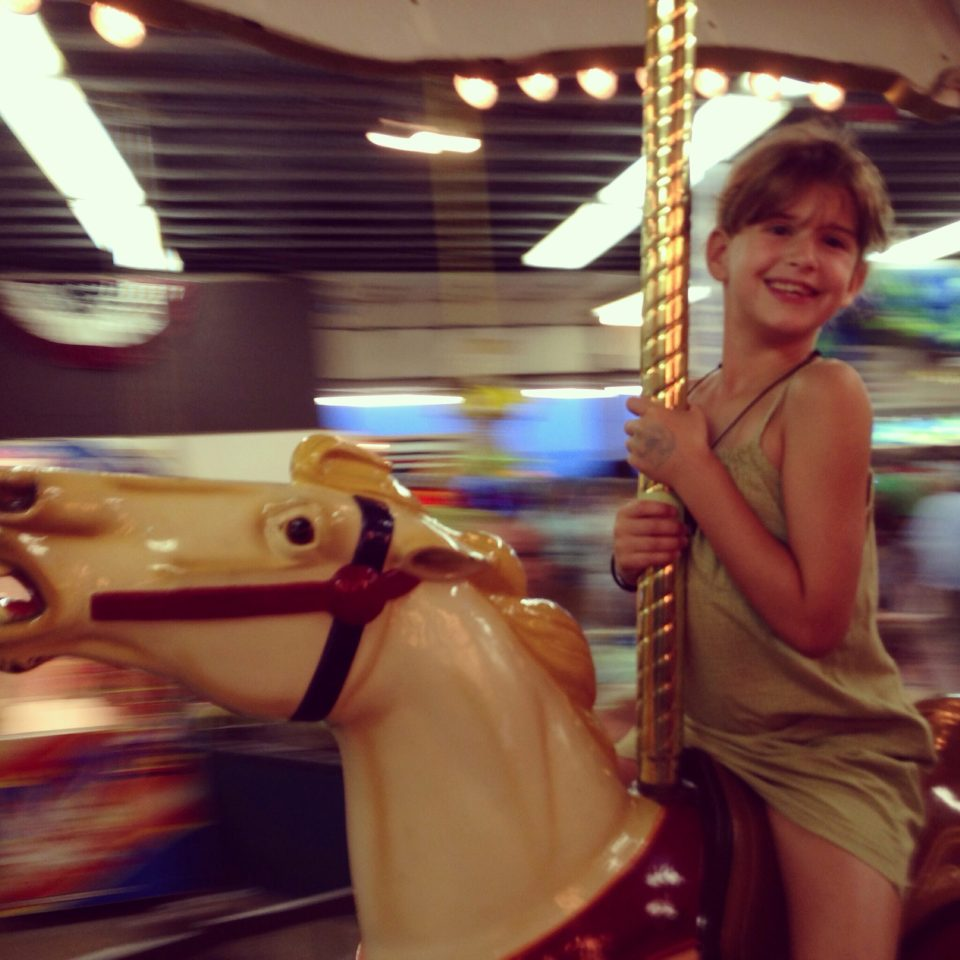 M on carousel horse
