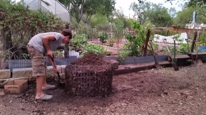 Luke turning the compost pile. Satisfaction in Making Compost.