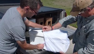 Placing nuc hives in laundry bags to contain the honey bees.