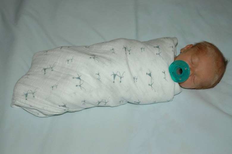 Tightly swaddled newborn baby