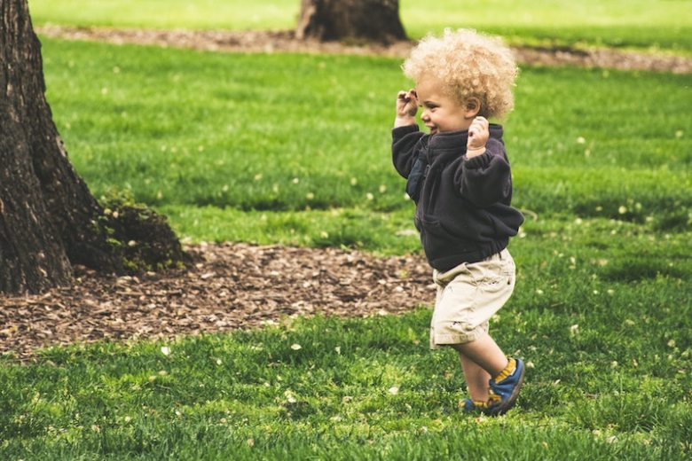 A toddler boy running