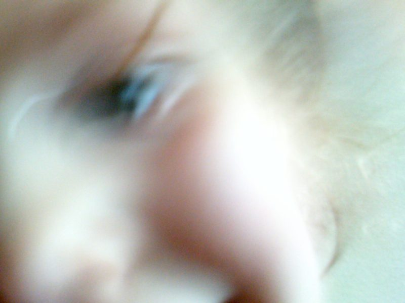 Image of a blurry self portrait of a child