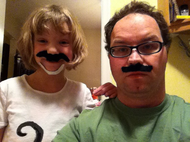 Image of father and daughter wearing moustaches