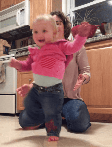 toddler taking first steps