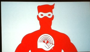 Image of a silhoutted man wearing a mask with the United Way Ottawa logo on his chest