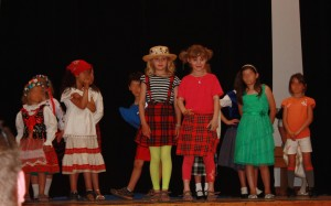 Image of kids in cultural dress at a multicultural fashion show