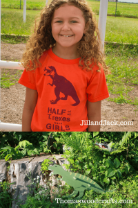 "Image of a girl wearing a t-rex t-shirt with text ""Half of all T-rexes were girls"" and image of a wooden t-rex clothes hook from Thomas Woodcrafts"