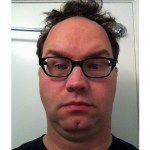 Image of a white male writer with bed head