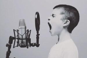 kid listening to music