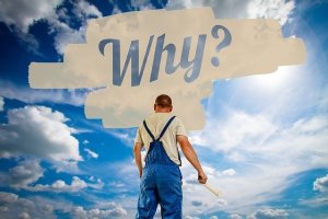Man standing above a why