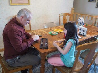 Papa spent part of an afternoon playing board games with the kids. The kids are really good at Mancala, and Papa lost as many games as he won,