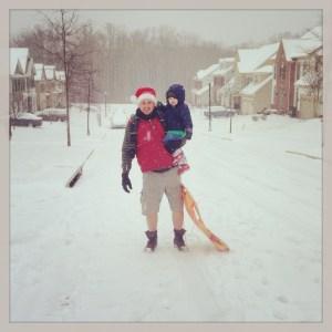 Daddy and Charlie sledding