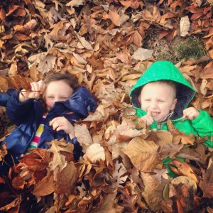 ava and charlie in leaves 2014