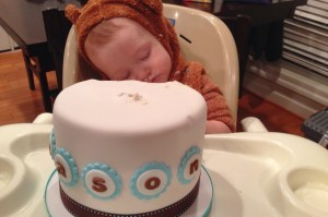 Mason asleep on his cake